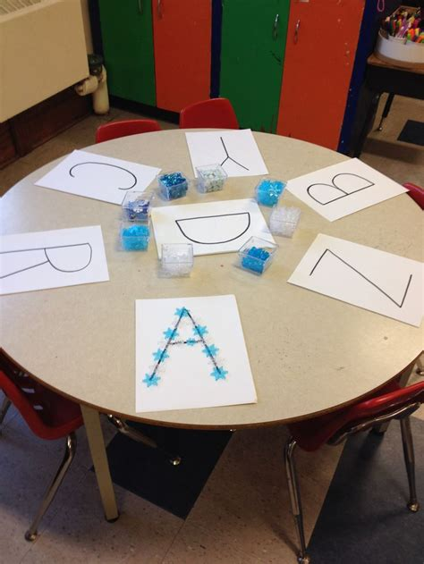 snow letters  loose parts pre writing activities
