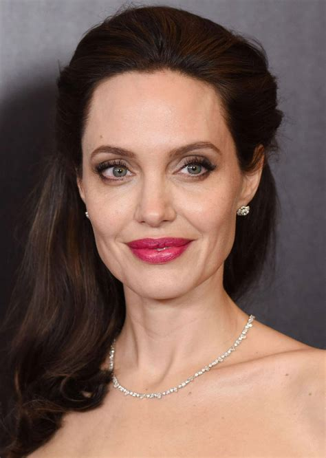 Angelina Jolie shows off her back tattoos at 'First They ...