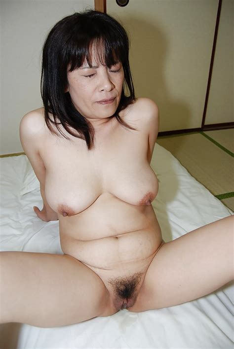Nasty Asian Brunette Yumiko Washing Her Tight Mature Pussy