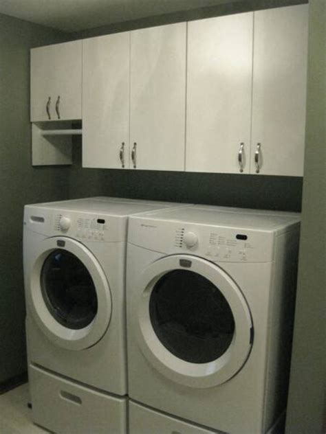 cabinets over washer and dryer laundry room