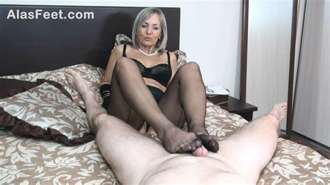 Experienced Mature Blonde Is Wearing Black Stockings While