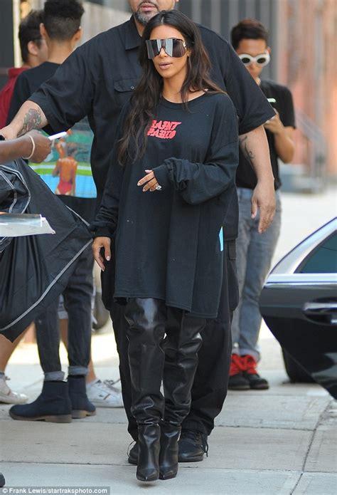 kim kardashian dons kanye wests saint pablo  shirt