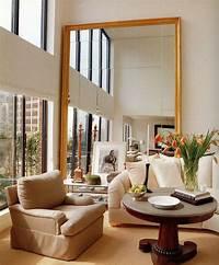 living room mirrors 10 Impressive Oversized Mirrors to Make Any Room Feel Bigger