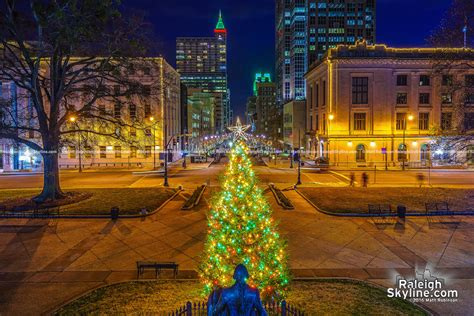 north carolina state capitol christmas tree with downtown
