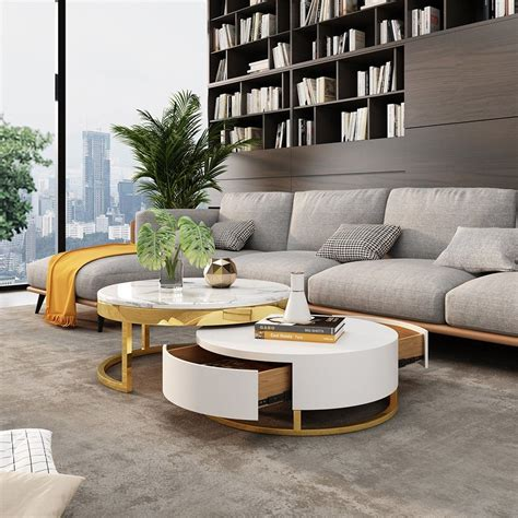 This modern and contemporary table is simple in shape and chic in color, can perfectly compatible with your. Modern Round Coffee Table with Storage Lift-Top Wood Coffee Table with Rotatable Drawers in ...