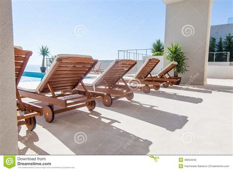 luxury swimming pool and deck chair