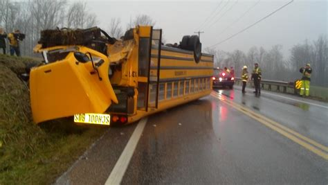 School Bus Crashes; Flips Over In Adams County