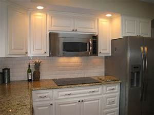 same color counter top but with white backsplash With kitchen cabinets lowes with purple and gold wall art