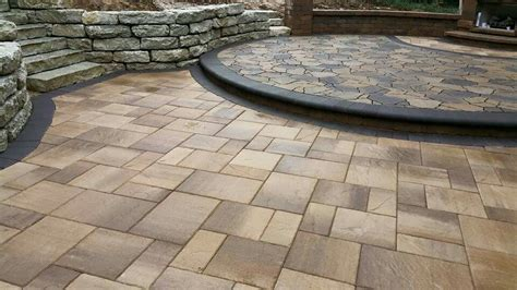 belgard lafitt patio slab with a charcoal bullnose step up