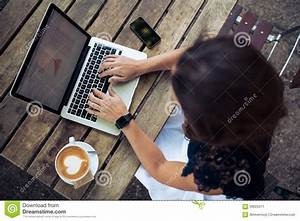Woman Using Her Laptop At A Coffee Shop Stock Photo ...