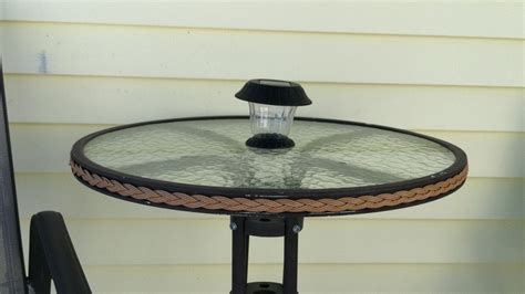 solar light in patio table where the umbrella is