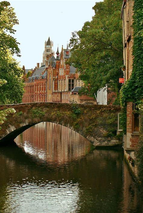 bridge  canal bruges belgium places  travel