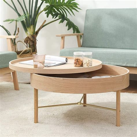 This is why a coffee table with storage comes as a rescue for a lot of people who do not find space to keep the the wood used in making this kind of coffee table are generally lighter than other types of wood options and there will. J&Y Round Storage Coffee Table, Solid Wood Round Screw-on Coffee Table, Light and Simple Storag ...