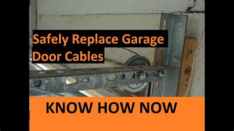 How To Put On Garage Door by How To Replace Broken Garage Door Cable