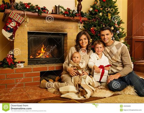 family  fireplace  christmas house stock photo