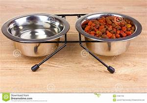 Dry Cat Food And Water In Bowls On Wooden Stock Photos ...