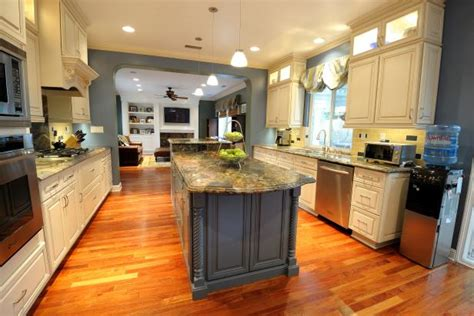 spacious transitional galley kitchen  warm mahogany