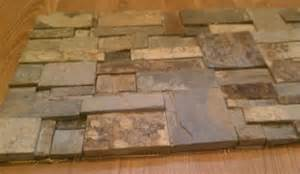 stack random slate mosaic tiles no grout joints wall