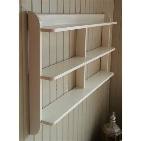 wide wall mounted open  shelf unit painted kitchen