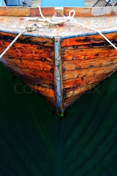 close    small wooden fishing boat stock photo