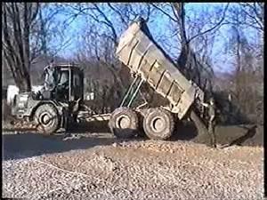 Dump Truck Moxy at Work Dumping River Gravel - YouTube