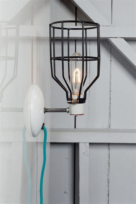 industrial wall sconce black wire cage light plug in