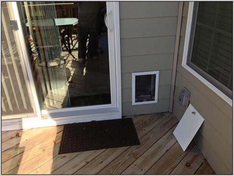 door with doggie door built in sliding door with door built in patios home
