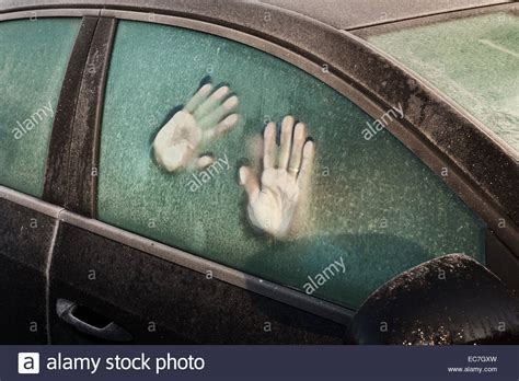 Hand Print Like Foot Prints Melted Frost On Window To Car