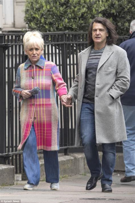 Barbara Windsor and husband Scott stroll through London ...