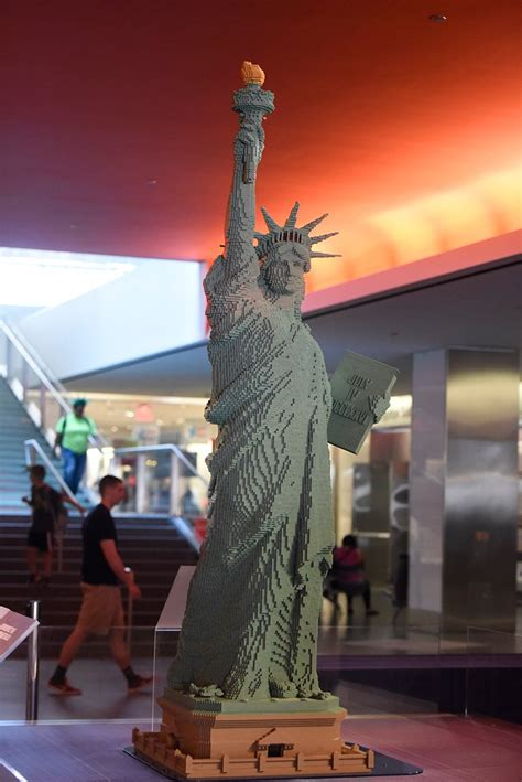 foot lego statue  liberty greets visitors