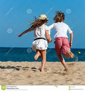 Boy And Girl Running Towards Sea. Stock Photography ...