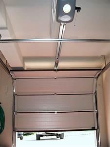 Depannage reparation portes de garages bruxelles for Porte de garage sectionnelle crawford