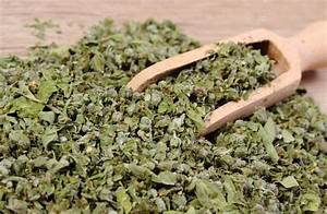 Dried marjoram with spoon on wooden background — Stock ...