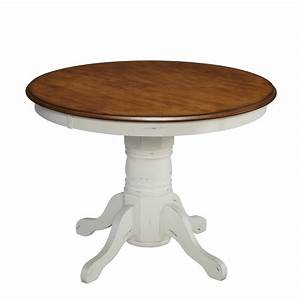Brown stained wooden dining tables using wooden pedestal for Round pedestal kitchen table