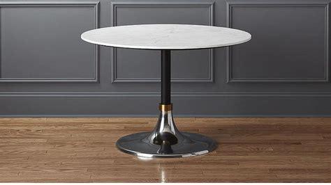 white top  black base square pedestal table