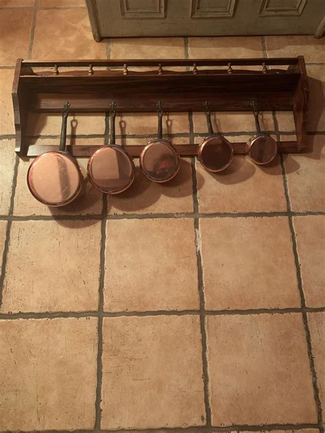 set   vintage french copper lined saucepans  wall rack etsy   french vintage
