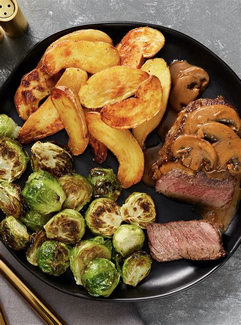 Beef tenderloin, or eye fillet, as it's known in other parts of the world, is cut from the middle of a cow. Beef Tenderloin with Mushroom Sauce with Roasted Brussels Sprouts & Fingerling Potatoes | Recipe ...