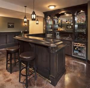 l shaped basement bar has corner cut at an angle with sink and mini wine chiller