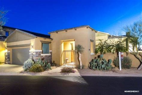 patio home with lake views in the guard gated community of