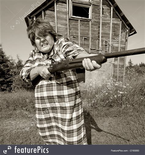 anger emotions angry woman  big gun stock picture