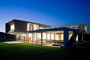 U-Shaped House with Glass Lower Floor and Concrete Upper
