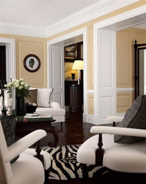warm white living room chic living room warm wall color white trim dark floors white furniture zebra rug