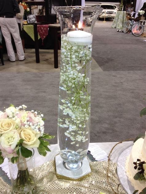 Babys Breath Submerged In Water W Floating Candle On Top