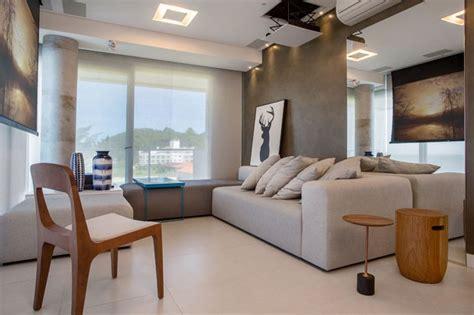 apartamento minimalista enfatiza  integracao   mar em