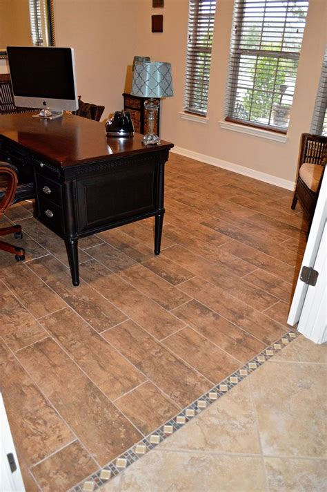 replacing hardwood floors with tile replace carpet with tile that looks like wood planks we