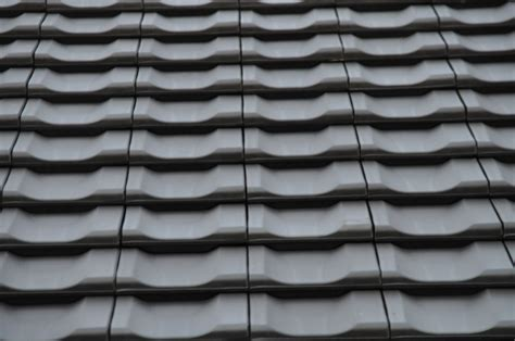 dachziegel mit mastdurchführung dacheindeckung mit engobiertem ziegel jacobi z10 in altschwarz hausbau