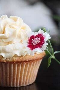 coconut cupcake with mango whipped cream frosting ...