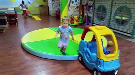 Indoor Playground. Funny Children Run, Jump And Play With
