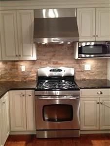 1000 images about backsplash on pinterest stone With kitchen cabinets lowes with rock climbing wall art