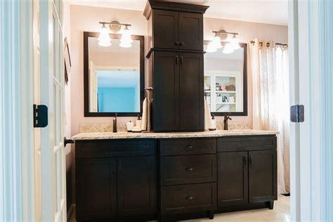 custom double vanity  center tower   bathroom